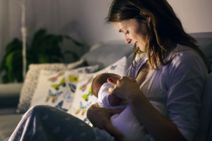 Young Beautiful Mother, Breastfeeding Her Newborn Baby Boy At Ni
